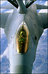 An F-16 refuels from a KC-135 tanker aircraft somewhere over Missouri.