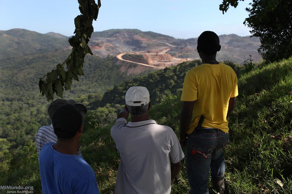 Community members from La Cerca view Barrick and Goldcorp's Pueblo Viejo open-pit gold mine from the Cerrro del Chivo peak. Cotuí, Sánchez Ramírez, Dominican Republic. April 2012.