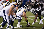 The Los Angeles Rams offensive line gets set at the line of scrimmage opposite the Oakland Raiders defensive line during the 2018 regular season week 1 NFL football game against the Oakland Raiders on Monday, Sept. 10, 2018 in Oakland, Calif. The Rams won the game 33-13. (©Paul Anthony Spinelli)