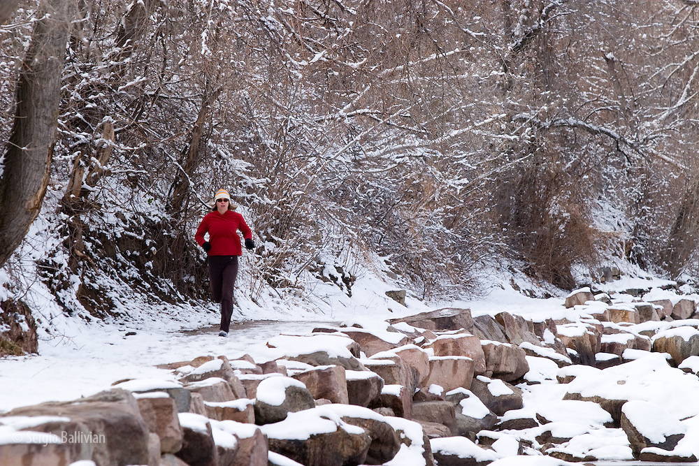 A male athlete runs along a trail in the foothills of the Rocky Mountains near Boulder, Colorado