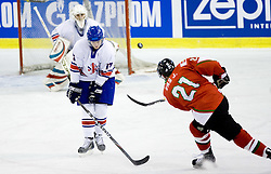 Russell Cowley of Great Britain vs VAS János of Hungary  at IIHF Ice-hockey World Championships Division I Group B match between National teams of Great Britain and Hungary, on April 21, 2010, in Tivoli hall, Ljubljana, Slovenia.  (Photo by Vid Ponikvar / Sportida)