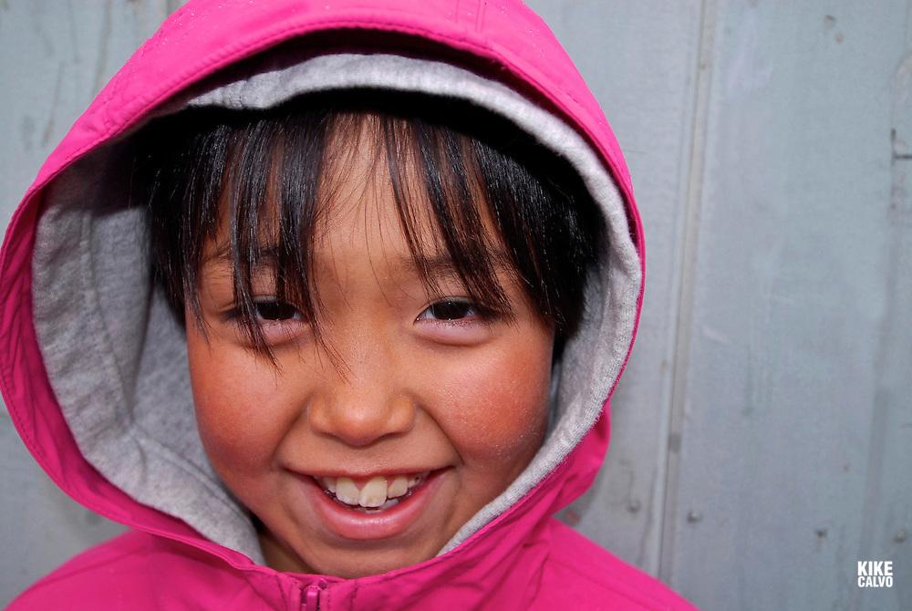 School playground. Coastal Inuit community of Arctic Bay. Lancaster Sound. HIgh Arctic. Baffin Island. <br /> (people, children, kid, girl, boy, teen, cute, playing, class, break ,.