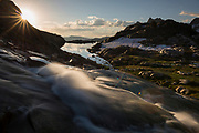 Sunrise landscape shot of stream at lower Nydiver Lake in the Ansel Adams Wilderness. High Sierra backpacking trip to Garnet Lake and Nydiver Lake in the Ansel Adams Wilderness out of Devil's Postpile national monument 2017.