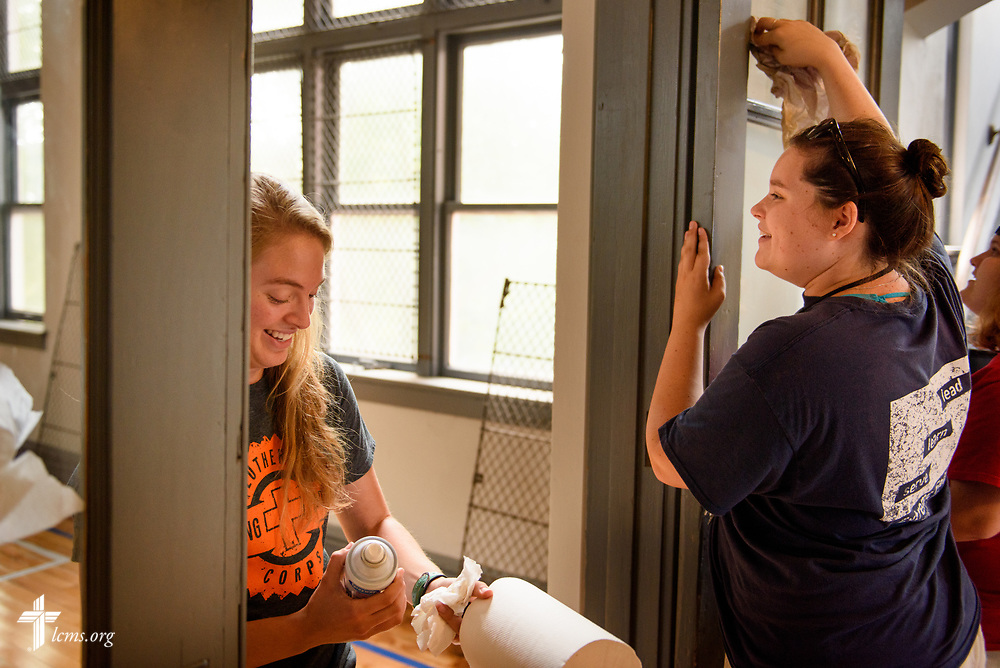Megan Barz (left) and Elizabeth Grobner of Lutheran Young Adult Corps serve Thursday, Aug. 10, 2017, at Eagle College Prep in south St. Louis. LCMS Communications/Erik M. Lunsford