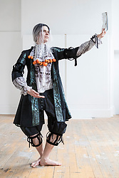 Spectacular costumes from a classic children's book, a sci-fi ballet and the Mexican underworld are showcased by University of Edinburgh students. <br /> <br /> The outfits have been designed by Performance Costume students for a jaw-dropping theatrical show. The Performance Costume Show takes place in Edinburgh College of Art's Sculpture Court on 18 and 19 May.<br /> <br /> Children's book favourite The Tiger Who Came to Tea is brought to life by student Gracie Martin's art deco design. She has imagined the tiger as a 1920s gangster wearing a pinstripe suit and tie.<br /> <br /> Yan Smiley has created characters for a sci-fi ballet set in 17th century Scotland. The outfit is inspired by stained glass windows and rugged Highland landscapes.<br /> <br /> Ellie Finch has made a dazzling outfit for Maid Marian, set in contemporary Mexico. The vibrant outfit highlights iconography linked to the country's drug cartels, with a headdress of poppies and needles and a kaleidoscopic skirt covered in prints of machine guns and cannabis leaves. <br /> <br /> Irvine Welsh's novel Marabou Stork Nightmares was the focus of Dayna Ali's surreal designs. She has created the Marabou Stork – half bird, half football hooligan. He has a large head and beak and wears fluorescent '90s sportswear with a specially made Marabou logo.<br /> <br /> Zoe Frewin has created costumes from Disney Pixar's animation, A Bug's Life. Inspired by George Orwell's 1984, the insects wear uniforms and their colour denotes their class in society.<br /> <br /> Pictured: Io Cleaver wearing a costume from the self-devised ballet Mr Walter The Scientist designed by Yan Smiley