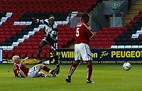 Photo. Andrew Unwin.Digitalsport<br /> Darlington v Barnsley, Carling Cup First Round, Williamson Motors Stadium, Darlington 24/08/2004.<br /> Barnsley's Bobby Hassell (L) tries to block an early shot from Darlington's Matt Clarke (C).