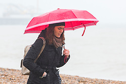 © Licensed to London News Pictures. 20/01/2018. Brighton, UK. Members of the public shelter from the rain in brighton and Hove as wet and grey weather is hitting the South coast. Photo credit: Hugo Michiels/LNP
