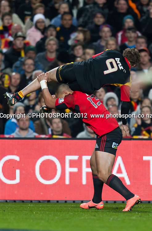 Crusaders' Robbie Fruean tackles Chiefs' Tawera Kerr-Barlow above his head during the Super Rugby Semi Final won by the Chiefs (20-17) against the Crusaders at Waikato Stadium, Hamilton, New Zealand, Friday 27 July 2012. Photo: Stephen Barker/Photosport.co.nz