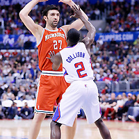 24 March 2014: Milwaukee Bucks center Zaza Pachulia (27) looks to pass the ball over Los Angeles Clippers guard Darren Collison (2) during the Los Angeles Clippers 106-98 victory over the Milwaukee Bucks at the Staples Center, Los Angeles, California, USA.