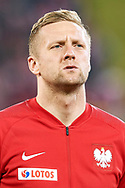 Chorzow, Poland - 2018 March 27: Kamil Glik from Poland listens national anthem before Poland v South Korea International Friendly Soccer match at Stadion Slaski on March 27, 2018 in Chorzow, Poland.<br /> <br /> Mandatory credit:<br /> Photo by © Adam Nurkiewicz / Mediasport<br /> <br /> Adam Nurkiewicz declares that he has no rights to the image of people at the photographs of his authorship.<br /> <br /> Picture also available in RAW (NEF) or TIFF format on special request.<br /> <br /> Any editorial, commercial or promotional use requires written permission from the author of image.