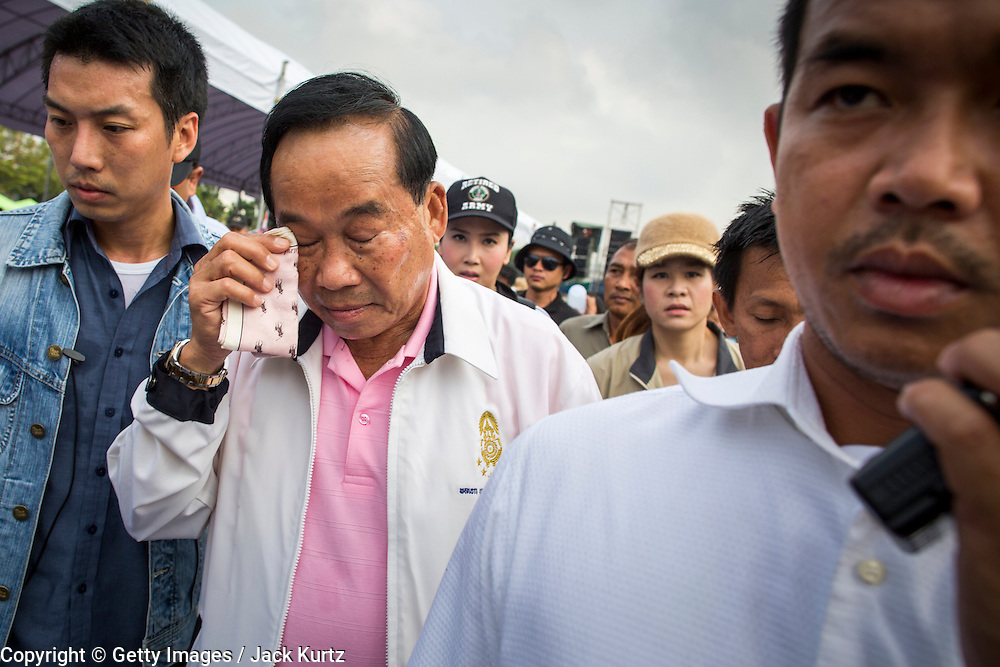 """24 NOVEMBER 2012 - BANGKOK, THAILAND: Gen Boonlert """"Seh Ai"""" Kaewprasit, leader of Pritak Siam and organizer of the anti-government rally wipes sweat from his forehead as he walks through the crowd during a large anti government, pro-monarchy, protest  on November 24, 2012 in Bangkok, Thailand. The Siam Pitak group, which sponsored the protest, cited alleged government corruption and anti-monarchist elements within the ruling party as grounds for the protest. Police used tear gas and baton charges againt protesters.       PHOTO BY JACK KURTZ"""