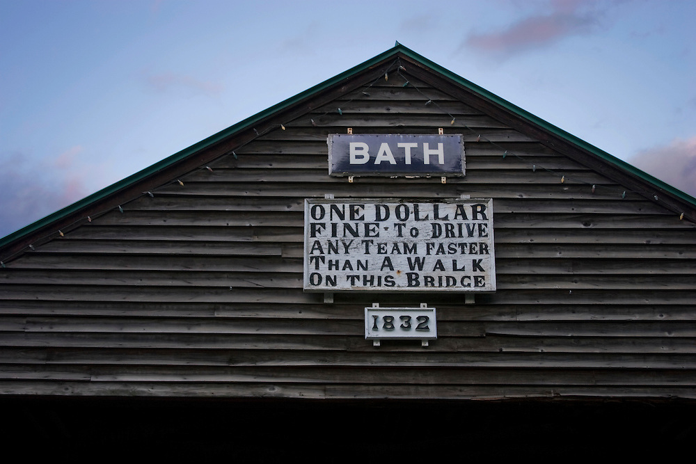 Sign on top of covered bridge in Bath