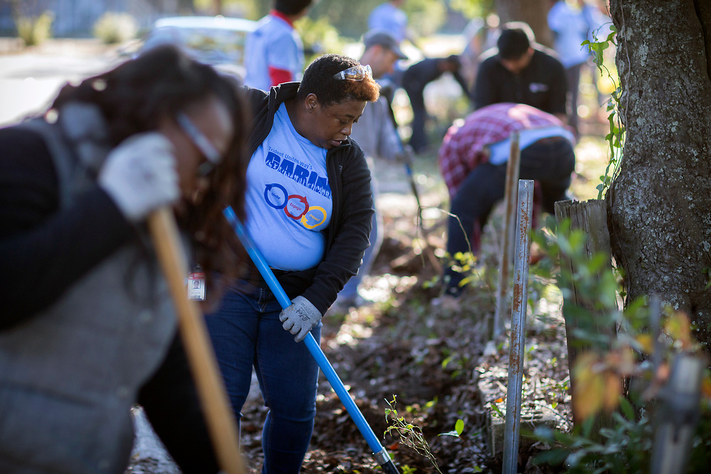 NOVEMBER, 17, 2017 - NORTH CHARLESTON, S.C.- A group of volunteers from Cumming, Inc., and the United Way Day of Caring  work to clear debris from an empty lot where Metanoia plans to build affordable housing near the school. (BNG/Stephen B. Morton)