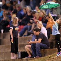 Adam Robison | BUY AT PHOTOS.DJOURNAL.COM<br /> Kaydee Sioux Carter, 5, of Pontotoc, plays with her umbrella before kickoff of the Pontotoc against Amory game Friday night in Pontotoc