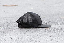 © Licensed to London News Pictures . 12/08/2018. Manchester , UK . A baseball cap in the middle of the road . Police have closed off Claremont Road in Moss Side after a shooting overnight during the annual Caribbean Carnival celebrations . Ten people are in hospital . Photo credit : Joel Goodman/LNP