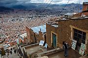 At the highest area of El Alto, beside of La Paz, Bolivia, the Cholita's wrestling show takes place every Sunday, in El Alto, Bolivia, February 19, 2012.<br /> SPANISH: Escarpadas escaleras sirven para llegar al edificio Multifuncional de El Alto, lugar donde cada domingo se llevan acabo las presentaciones de lucha libre de las Cholitas. Al fondo, enclavada en monta&ntilde;as se puede observar la ciudad de La Paz, pintada de rojo por el ladrillo de sus construcciones y sus edificios de gran altura que contrastan con lo sencillo de las construcciones de adobe y techos de lamina de la ciudad de El Alto.