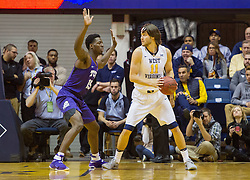 Jan 7, 2017; Morgantown, WV, USA; West Virginia Mountaineers forward Nathan Adrian (11) backs down and is guarded by TCU Horned Frogs forward JD Miller (15) during the first half at WVU Coliseum. Mandatory Credit: Ben Queen-USA TODAY Sports