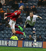Matt Mills and Joe Garner batle during the Sky Bet Championship match between Preston North End and Nottingham Forest at Deepdale, Preston, England on 3 November 2015. Photo by Pete Burns.