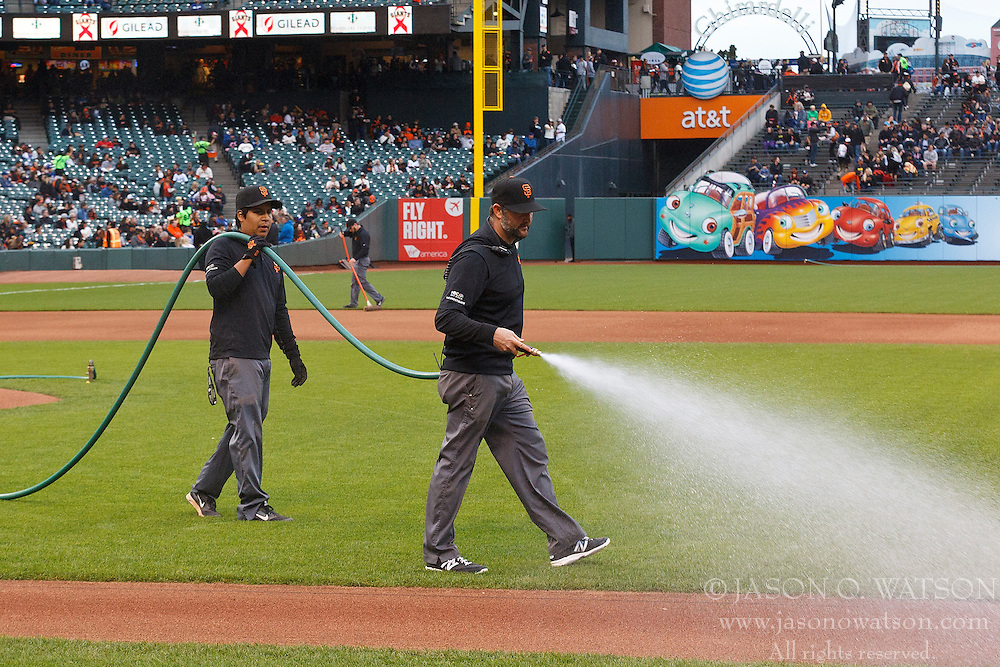 SAN FRANCISCO, CA - MAY 20:  Members of the San Francisco Giants grounds crew water the field before the game against the Los Angeles Dodgers at AT&T Park on May 20, 2015 in San Francisco, California.  The San Francisco Giants defeated the Los Angeles Dodgers 4-0. (Photo by Jason O. Watson/Getty Images) *** Local Caption ***