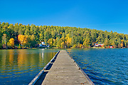 Dock and cottages and Autumn on Crow Lake (also known as Kakagi Lake).<br />Near Sioux Narrows<br />Ontario<br />Canada