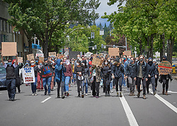 Participants march along a street during a June 7, 2020, Black Lives Matter protest in Eugene, Oregon. Participants were protesting the murder of George Floyd and other African-Americans by police.