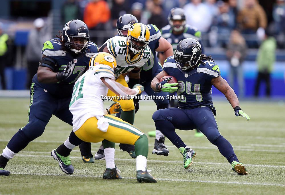 Seattle Seahawks running back Marshawn Lynch (24) makes a cut as he avoids tackle attempts by Green Bay Packers free safety Ha Ha Clinton-Dix (21) and Green Bay Packers defensive end Datone Jones (95) during the NFL week 20 NFC Championship football game against the Green Bay Packers on Sunday, Jan. 18, 2015 in Seattle. The Seahawks won the game 28-22 in overtime. ©Paul Anthony Spinelli