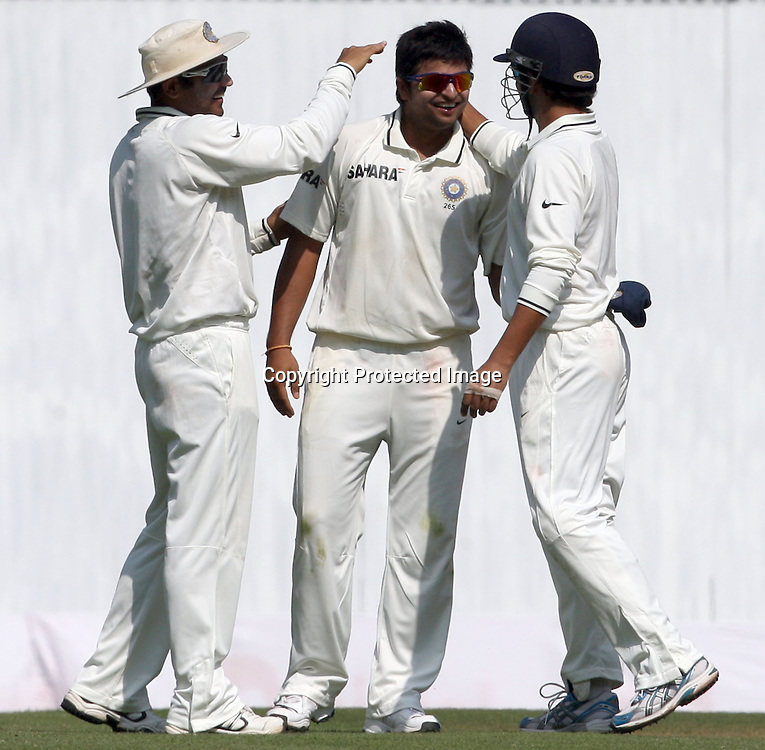 Indian player Suresh Raina celebrates with Virender Sehwag and Gautam Gambhir New Zealand batsman  Daniel Vettori wicket during the 3rd test match India vs New Zealand day-4 Played at Vidarbha Cricket Association Stadium, Jamtha, Nagpur, 23 November 2010 (5-day match)November 2010 (5-day match)