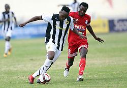 Cercidy Okeyo of Tusker FC shields against Eric Kibiru of Posta Rangers during their Sportpesa Premier League tie at Nyayo Stadium in Nairobi on July 29, 2017. Posta won 1-0. Photo/Fredrick Omondi/www.pic-centre.com(KENYA)
