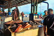 Merchants and buyers in a seafood market.  Port of Manta. Ecuador.