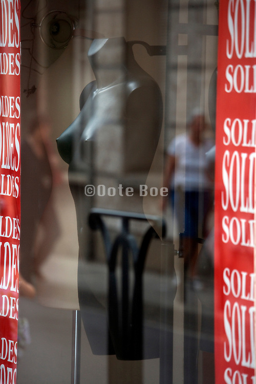 female mannequin torso displayed in a window