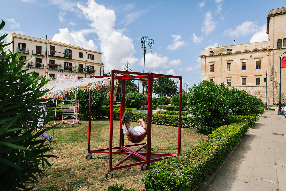 PALERMO, ITALY - 15 JUNE 2018: A resident of Palermo is seen here in Piazza Kalsa during Manifesta 12, the European nomadic art biennal, in Palermo, Italy, on June 15th 2018.<br /> <br /> Manifesta is the European Nomadic Biennial, held in a different host city every two years. It is a major international art event, attracting visitors from all over the world. Manifesta was founded in Amsterdam in the early 1990s as a European biennial of contemporary art striving to enhance artistic and cultural exchanges after the end of Cold War. In the next decade, Manifesta will focus on evolving from an art exhibition into an interdisciplinary platform for social change, introducing holistic urban research and legacy-oriented programming as the core of its model.<br /> Manifesta is still run by its original founder, Dutch historian Hedwig Fijen, and managed by a permanent team of international specialists.<br /> <br /> The City of Palermo was important for Manifesta&rsquo;s selection board for its representation of two important themes that identify contemporary Europe: migration and climate change and how these issues impact our cities.