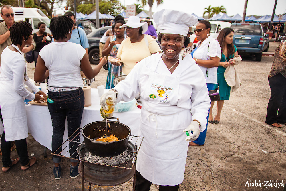 Shirley Honore prepares saltfish cakes to go with johnny cakes, vegetarian stew, and Sancoach, a dominican dish, featuring papaya, salmon, and coconut milk.  Coal Pot Cook-Off  at Emancipation Garden raising funds for St. Thomas Historical Trust.  St. Thomas, VI.  19 May 2015.    © Aisha-Zakiya Boyd