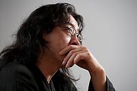 2010, BERLIN/GERMANY:<br /> Bei Ling (vollstaendiger Name Huáng Bèi Lǐng), chinesischer Schriftsteller, Poet, Essayist und Dissident, waehrend einem Interview, ehem. Stasi Gefaengnis und heutige Gedenkstaette Hohenschoenhausen<br /> IMAGE: 20101209-01-028