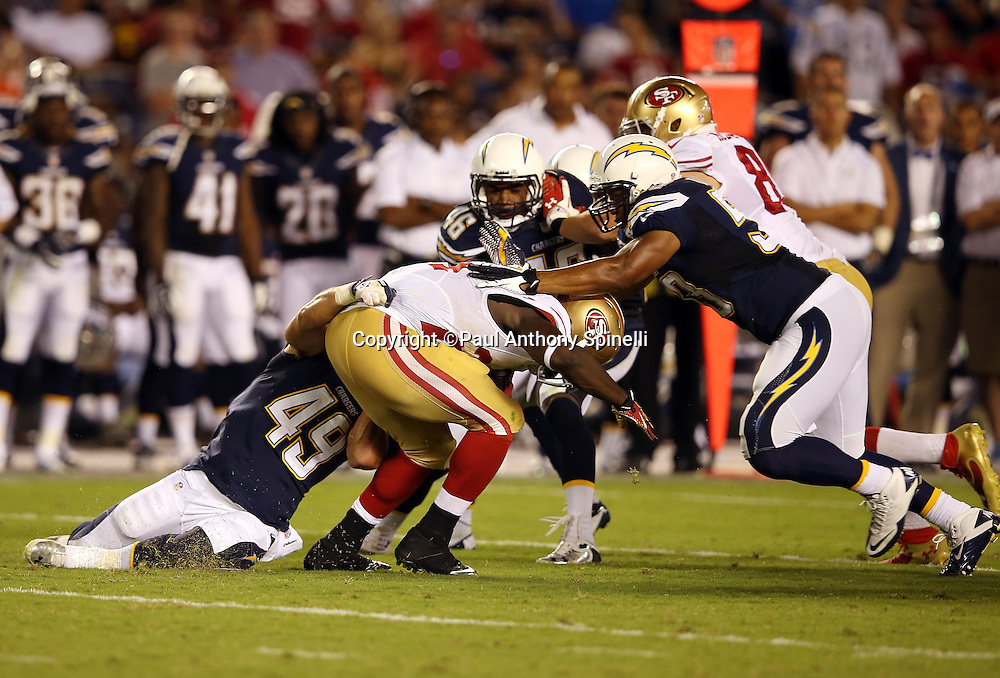 San Francisco 49ers running back Anthony Dixon (24) gets gang tackled while running the ball in the third quarter during the NFL week 4 preseason football game against the San Diego Chargers on Thursday, Aug. 29, 2013 in San Diego. The 49ers won the game 41-6. ©Paul Anthony Spinelli