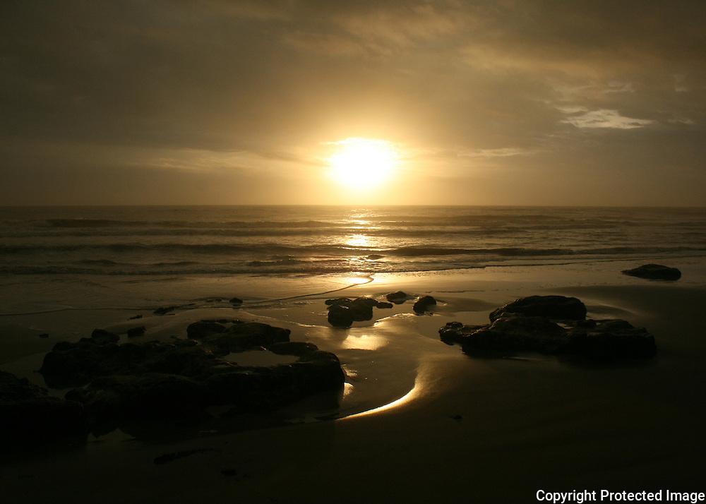 A Golden sunrise, sunset, on a moonscape Jekyll Island beach.