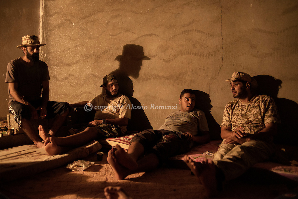 Libya: Fighters sympathising with Libya's Government of National Accord's (GNA) relax at their base on the outskirts of Sirte in the last day of Ramadan. Alessio Romenzi