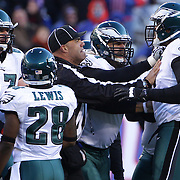 Referees intervene during a confrontation during the New York Giants V Philadelphia Eagles NFL American Football match at MetLife Stadium, East Rutherford, NJ, USA. 30th December 2012. Photo Tim Clayton