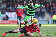 Morecambe's Dean Winnard(6) tackles Forest Green Rovers Alex Bray(31) is shown a yellow card, booked during the EFL Sky Bet League 2 match between Morecambe and Forest Green Rovers at the Globe Arena, Morecambe, England on 17 February 2018. Picture by Shane Healey.