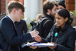 Great Ormond Street Hospital, London, April 26th 2016. A member of the public signs a petition as striking junior doctors picket outside Great Ormond Street Hospital for Children.
