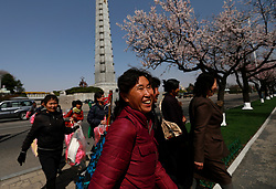 North Korean women walk past the Tower of the Juche Ider after a rehearsal for 'Day of the Sun Festival' celebrations in Pyongyang, North Korea, 12 April 2017. North Koreans prepare to celebrate the 'Day of the Sun Festival', 105th birthday anniversary of former North Korean supreme leader Kim Il-sung in Pyongyang on 15 April.