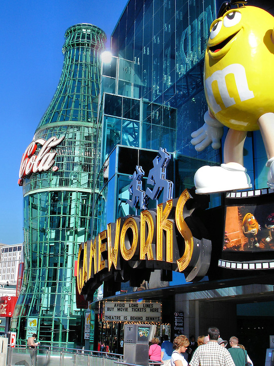 Showcase Mall Entrance in Las Vegas, Nevada <br /> The entrance of Showcase Mall features a giant Coca Cola bottle and several colorful M&amp;M characters. M&amp;M&rsquo;s World opened in 1997 as the first store dedicated to the famous candy plus every other imaginable product from Mars, Incorporated.  Since this photo was taken, GameWorks has moved their 125 video games to Town Square.