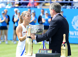 Dominika Cibulkova of Slovakia is presented the trophy after winning the Aegon International Eastbourne singles tournament by beating Karolina Pliskova ( not pictured ) of Czech Republic  - Mandatory by-line: Paul Terry/JMP - 25/06/2016 - TENNIS - Devonshire Park - Eastbourne, United Kingdom - Dominika Cibulkova v Karolina Pliskova - Aegon International Eastbourne