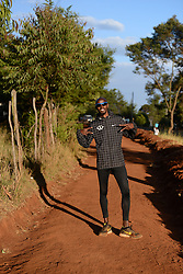 © Licensed to London News Pictures. Iten, Kenya. MO FARAH poses for a photograph. Double world and Olympic champion MO FARAH in training at an altitude training camp based at 2,500m in Iten, Kenya, ahead of the 2014 Virgin Money London Marathon in April this year. The Somalia born, adopted Brit, is looking to make the jump from the 10,000m distance to a full marathon for the first time in front of a home crowd. Photo credit : Mike King/LNP