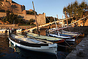 Traditional Catalan fishing sailing boats in the harbour with the Chateau Royal in the background, Collioure, France. Picasso, Matisse, Derain, Dufy, Chagall, Marquet, and many others immortalized the small Catalan harbour in their works. Picture by Manuel Cohen.
