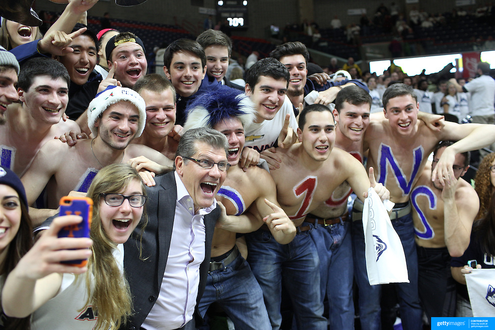 Head Coach Geno Auriemma, UConn, joins the UConn fans to celebrate victory after the Notre Dame Vs UConn Women's Basketball game at Grampel Pavilion, Storrs, Connecticut, USA. 5th December 2015. Photo Tim Clayton