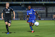 AFC Wimbledon attacker Michael Folivi (17) chases for ball with Brighton and Hove Albion defender Lewis Freestone (42) during the EFL Trophy (Leasing.com) match between AFC Wimbledon and U23 Brighton and Hove Albion at the Cherry Red Records Stadium, Kingston, England on 3 September 2019.
