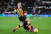 Hull City forward Jarrod Bowen (20) is tackled by a Swansea City player during the EFL Sky Bet Championship match between Hull City and Swansea City at the KCOM Stadium, Kingston upon Hull, England on 22 December 2018.