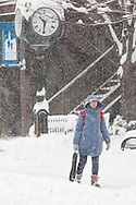 Middletown, New York - A woman walks down North Street during a snowstorm on Feb. 9, 2017.