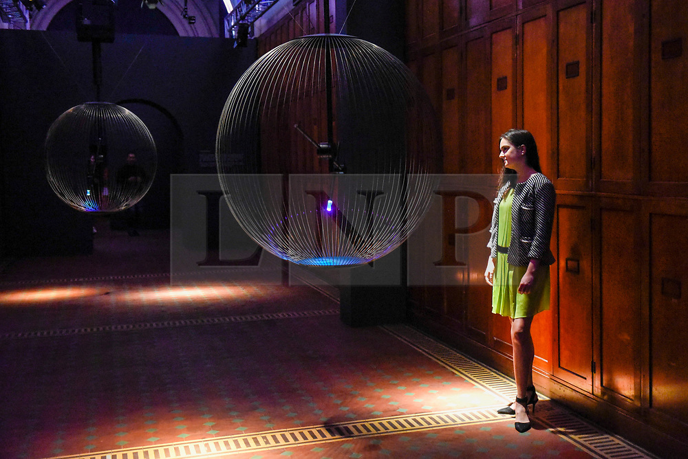 """© Licensed to London News Pictures. 13/09/2019. LONDON, UK. A staff member in """"Affinity in Autonomy"""" by Sony Design on display at the V&A museum as part of London Design Festival.  The festival, now in its 17th year, includes installations across the capital and runs 14 to 22 September 2019.  Photo credit: Stephen Chung/LNP"""