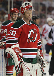 Mar 18; Newark, NJ, USA; New Jersey Devils goalie Martin Brodeur (30) during a break in the third period at the Prudential Center. The Washington Capitals defeated the New Jersey Devils 3-0.